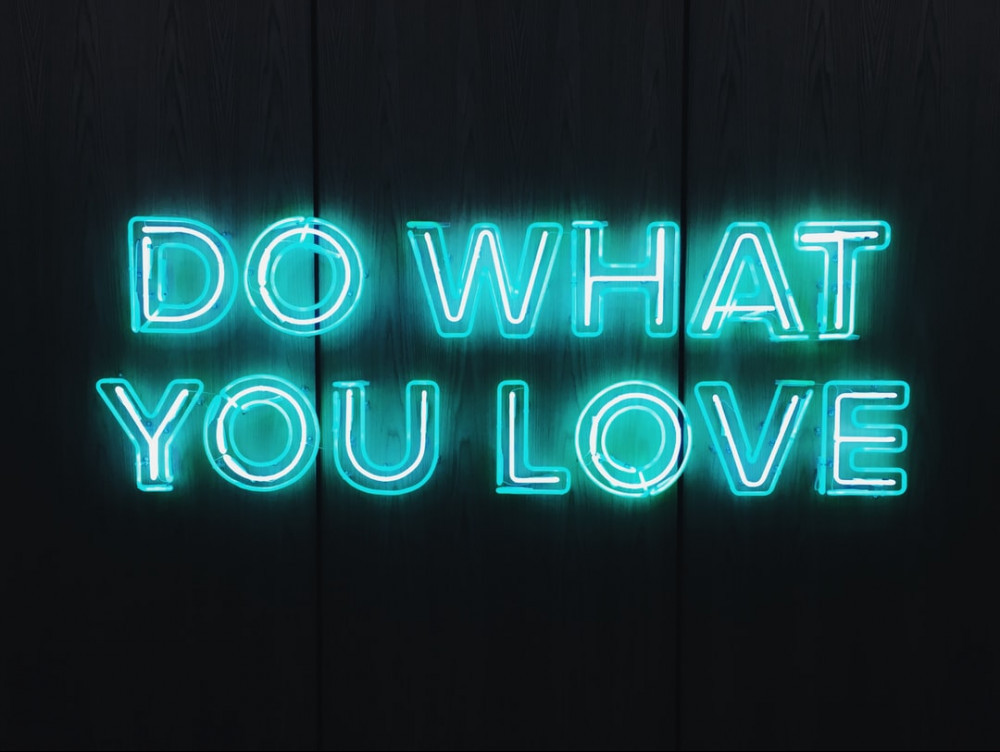 Black background with words in blue saying do what you love