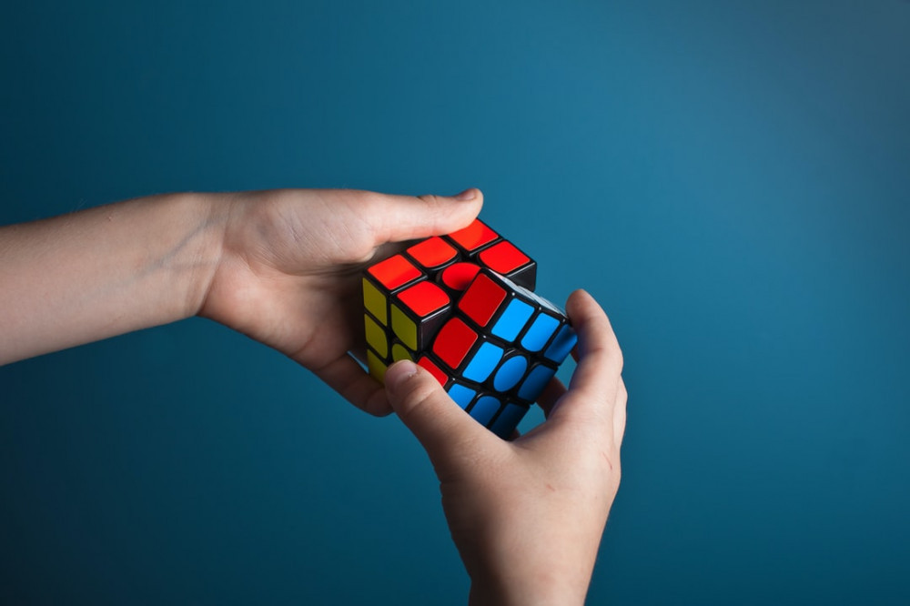 Person Solving Problems with Rubix Cube